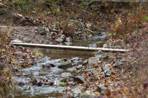 A small stream such as this one may not seem like much of an obstacle to the casual observer, but a little local history can tell you that most streams can get very big when the weather gets really nasty.