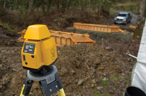 A laser level is the primary tool to transfer the elevations determined by the surveyor to the actual form elevations on the bridge site.