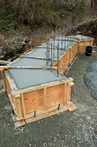 Before pouring concrete into the bridge footings, the Ford crew installed a grid of rebar that would tie the bridge footings together with the main beam supports.