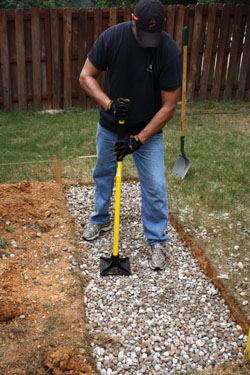 My first step was to excavate the slab location and tamp down a bed of gravel for the concrete.