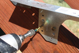 "I used four 1-1/2"" No. 8 cone-head exterior screws in the predrilled holes of each bracket."