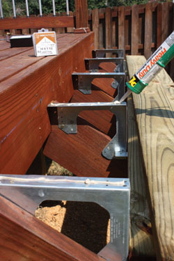 Using construction adhesive along the tops of the brackets will help reduce squeaking.