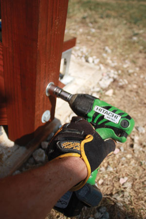 """The lower handrail posts were each anchored with a couple of 1/2"""" through bolts, nuts and washers."""