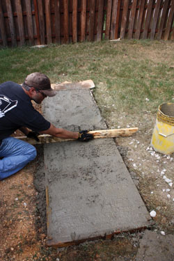 Screed the concrete even with the form.