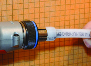 When the tool is triggered, the cam mechanism delivers continuous expansion to the ring and the PEX tubing.