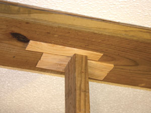 """Snug"" the studs in place. Use shims if necessary rather than banging them into position with a hammer, which might damage the floor or ceiling."
