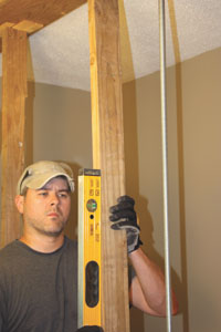Make sure the studs are plumb on each face and toe-screw them into place.