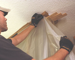 Use the brace wall as a frame to hang plastic sheeting as a dust barrier.