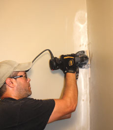 I used a Rotozip with a flush-cut accessory to cut through the perimeter of the drywall panels.