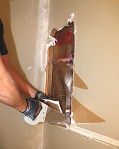 A drywall saw helps to remove the panels neatly, without smashing the gypsum board to dust and crumbles.