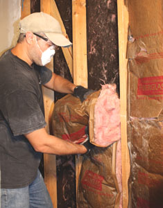 Use hand, eye and breathing protection when removing the old fiberglass batts.