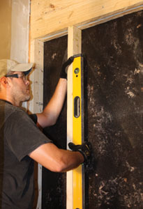 It's critical that the rough opening for the door be framed completely plumb, back to front and left to right.