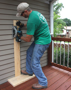 I used a 4-foot level to mark the plumb lines of the rough opening, then cut through the siding using a cordless circ saw with a homemade edge guide.