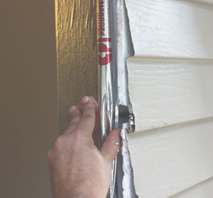 Wrap the door frame with weatherproof flashing. I used a self-adhesive flashing arrier fro Cofair Products.