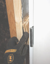 Plumb the hinge side of the door first, using shims as necessary. It's especially important to use shims behind the hinge plates.