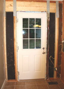 Shown Is The New Back Door Before Rebuilding Wall And Adding Paint Trim