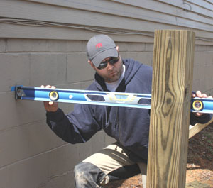 Determine the anticipated height of your deck, then measure downward, subtracting the thickness of the decking and the height of the joists and beam. Transfer this measurement to the posts to determine where to cut them to accept the beam.
