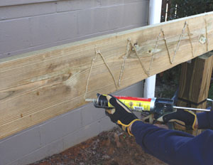 I laminated the beams together using a combination of construction adhesive and RSS screws from GRK Fasteners.