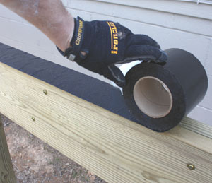 I covered the tops of the beams and joists with Deck Flash Barrier from Coffer Products to shed water and prevent rot.