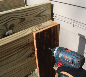 Shown here is the L-shaped jig I screwed to the ends of the joists during installation to serve as a spacer against the siding.