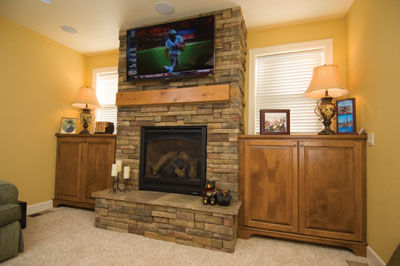 installed manufactured stone veneer using the drystack method on a fireplace interior. Here