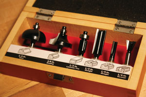 """Shown here is a set of commonly used 1/4"""" shank bits for both edge routing and groove routing."""