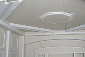 """The chamfer stop bead is installed with Trim-Tex 847 Spray Adhesive and 1/2"""" divergent staples. This photograph depicts the wide range of applications for various drywall corner beads."""