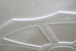 The wagon wheel is dry-fitted with Trim-Tex L-bead and Archway L-bead for accurate miters before installing.