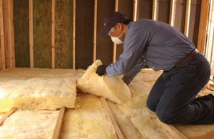 "Fiberglass is inexpensive and easy to install, making it the most popular type of insulation for builders and homeowners. Attics should have a minimum of 12"" of fiberglass insulation. (Photo courtesy Certainteed)"