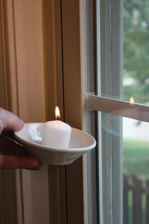 A simple way to check for air leaks is to use a burning candle or incense. Move the candle around the edges of doors and windows. Look for the smoke to flutter or flame to flicker, which indicates a leak.