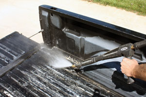 Pressure washing is a quick and powerful method to clean away the dirt and grime from the truck bed.
