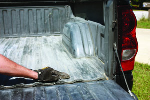 Scuff-sand every square inch of the truck bed prior to applying the liquid liner. After sanding, either pressure-wash or wipe down the bed with a rag and alcohol to remove the dust.