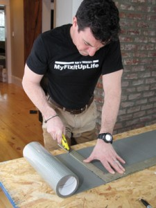 The adhesive mat is easy to cut and work with. We set up a quick work table and cut it with a utility knife, using a framing square as a straight-edge.