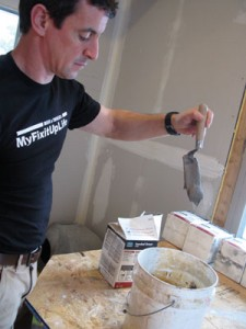 We like grout mixed to a consistency just a bit soupier than peanut butter. If it sags then slides off the margin trowel, you're in the zone.