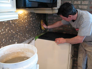 The key to wiping down grout effectively is to rinse the grout sponge often.