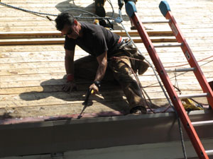 The gutter flashing, along with the rest of the 1x6 T&G roof deck needed to be re-nailed. A few hand nails here and there work fine, but for major deck nailing we used coil nailers.