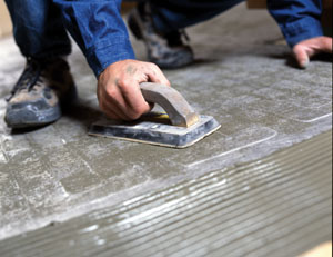 Use a rubber float to press the entire mat surface to firmly create 100-percent contact between the heating mat, the mortar and the subfloor.