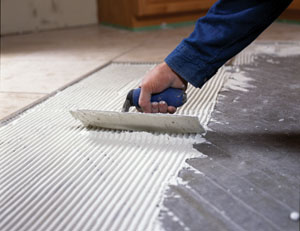 After the first layer of thin-set has cured, install the tile with a second layer of thin-set, which is applied with a 1/4 in. square notched trowel.