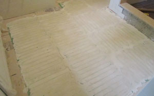The mortar provides a flat surface that's ready for the finished floor.