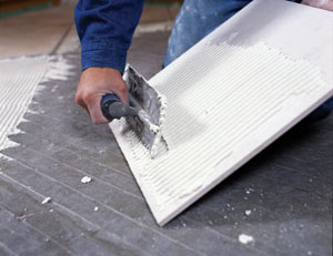It may help to butter the backs of the tiles with thin-set for better adhesion to the mortar bed.