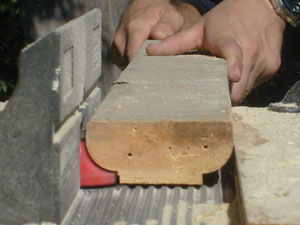 It helps to keep a fence on the router table to ensure a consistent cut.