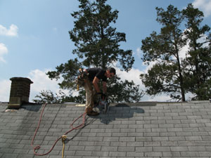 I scored the shingles with a circ saw before tear-off.