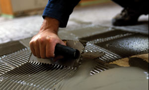"Use a 1/4"" x 1/4"" trowel to lay the thin-set for the solid mats."