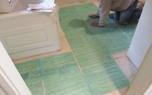 Wire-embedded mats are narrow and can be cut to fit around obstructions in small rooms.