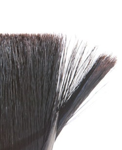 "Flags are just visible on some tips on this Chinexbristle brush. On synthetic-bristle brushes ""flags"" are added to the tips to simulate the ragged ends of natural bristle, so the brush holds more paint and releases it without brush marks."