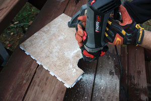 For straight cuts in tile, I used a wet saw. However, for irregular or oddly shaped cuts, I used a Rotozip equipped with a special tile-cutting bit.