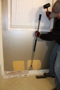 A long-handled tile scraper from Hyde Tools was a handy tool for removing the base-trim tile.
