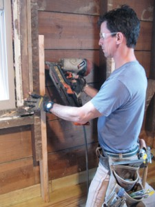 We glued and nailed 4' scabs to the edges of existing joists.