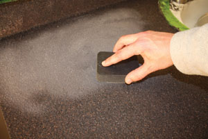 Once the glue has dried, sand the chips smooth with a diamond-embedded abrasive pad.