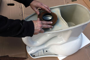 The toilet installation was a straightforward pull-and-replace procedure, beginning with the all-important wax ring.